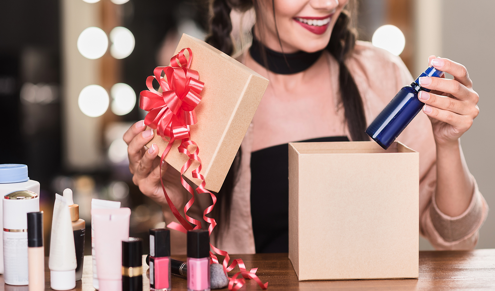 how-to-smell-great-on-a-budget-woman-opening-beauty-products