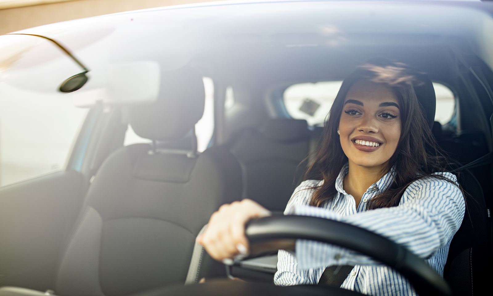must-have-car-tech-accessories-beautiful-woman-driving-her-car