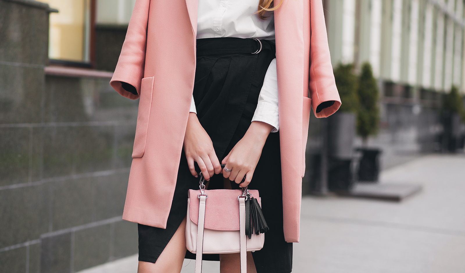 tips-for-buying-the-perfect-winter-coat-woman-wearing-coat-on-street-main-image