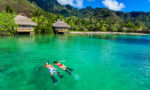 best-products-to-bring-on-vacation-or-use-for-staycation-couple-snorkeling-in-tropical-waters