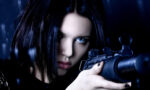 signs-you-need-an-eye-test-woman-with-camera-in-dark-background