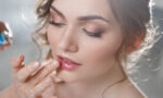 find-a-good-beauty-school-woman-applying-bridal-makeup-main-image-1160x719