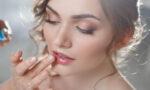find-a-good-beauty-school-woman-applying-bridal-makeup-main-image-1160x719