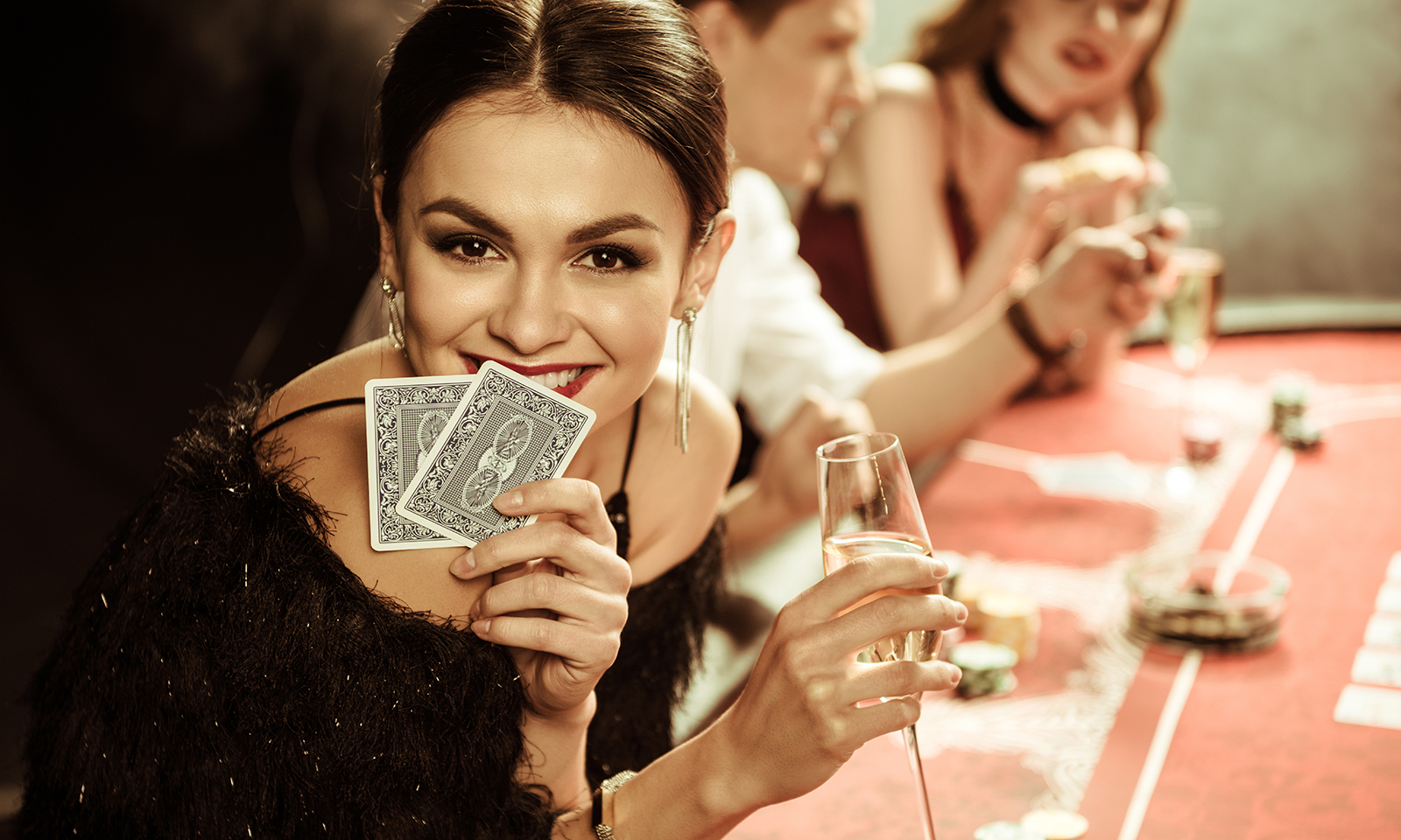 sports-betting-vs-casinos-which-odds-are-better-woman-with-cards-main-image