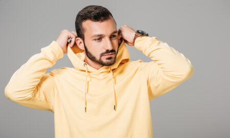 the-best-color-to-wear-based-on-your-zodiac-man-in-yellow-hoodie