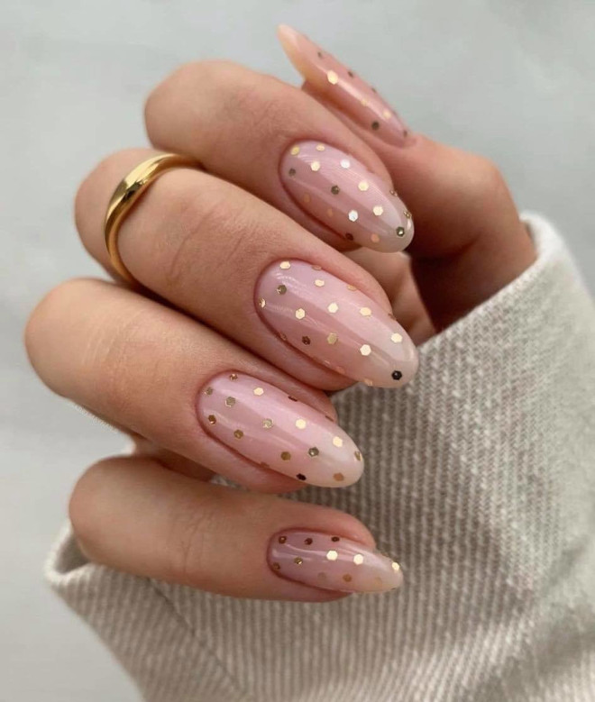 add glam vibes to your spring look with gold nails