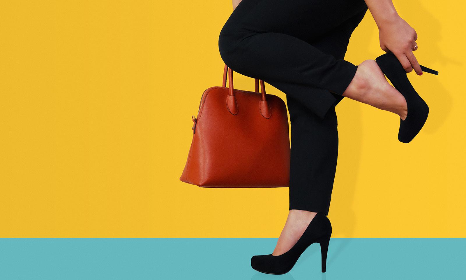 best-heels-for-your-first-date-woman-inblack-heels-grabbing-foot