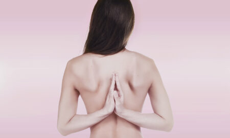 benefits-of-naked0-yoga-young-woman-naked-hands-together-main-image