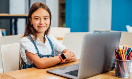 online-camp-for-kids-smiling-young-girl-on-computer