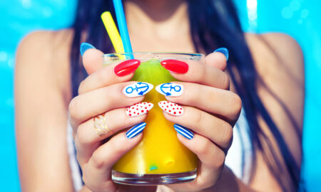 the-most-hydrating-healthy-snacks-for-summer-main-image-gir-with-nice-nails-holding-juice