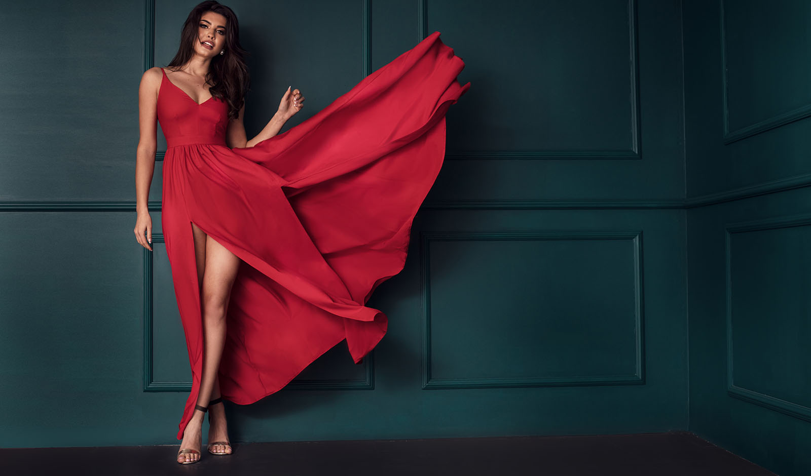 Fashion lady in red maxi dress.