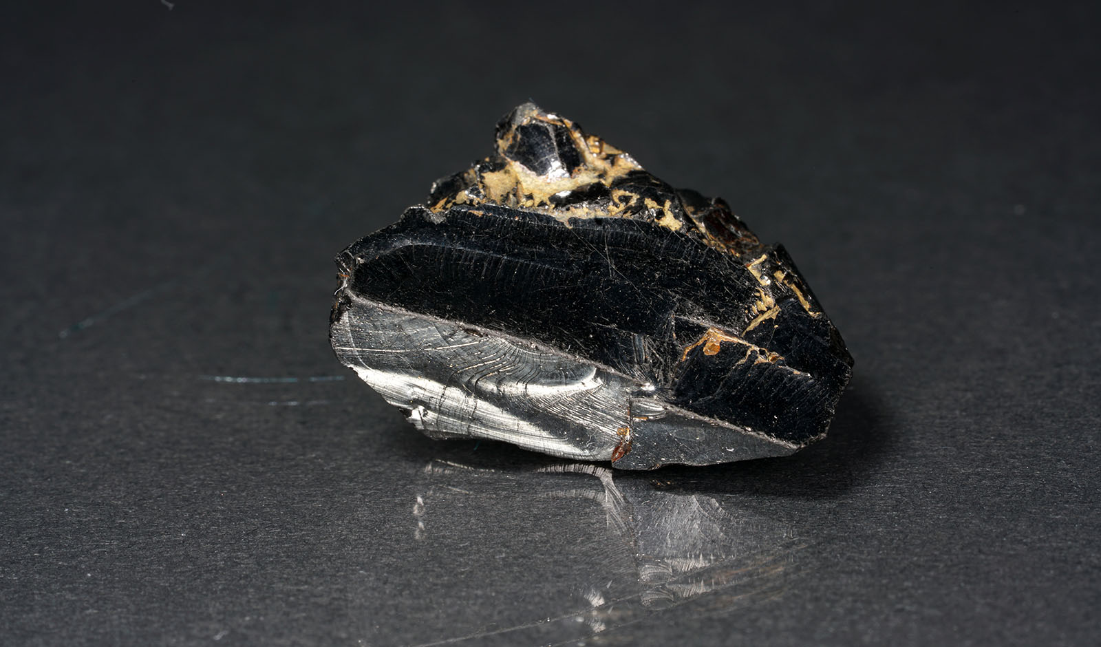 A black rock also called healing stone shungite, which consists