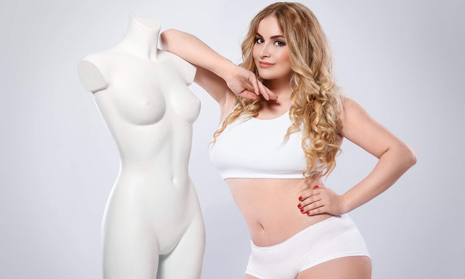 best-foods-you-can-eat-for-healthy-breasts-plus-size-model-next-to-manakin-sporta-bra