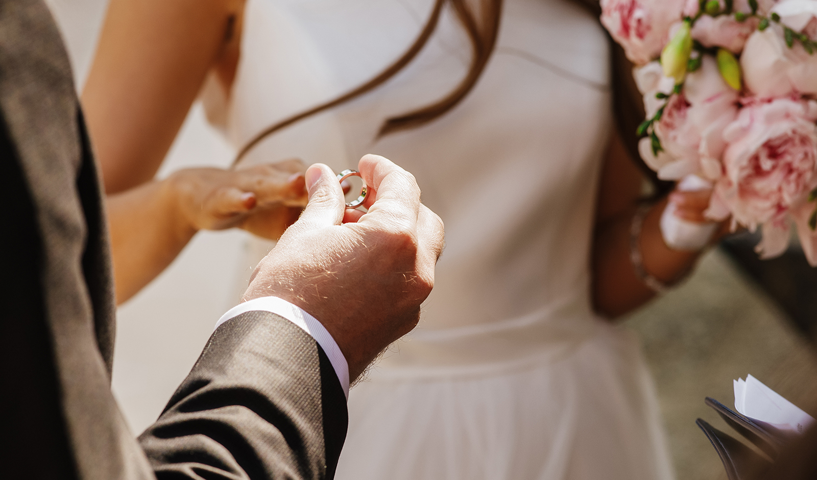 most-important-traits-to-look-for-in-a-lasting-partner-man-putting-ring-on-womans-finger