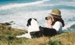 staycation-ideas-deal-with-bordeom-at-home-woman-and-dog-taking-pictures-by-the-water