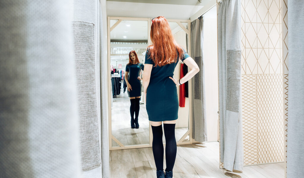 style-tips-that-can-help-boost-your-confidence-main-image-fashionable-woman-looking-in-the-mirror
