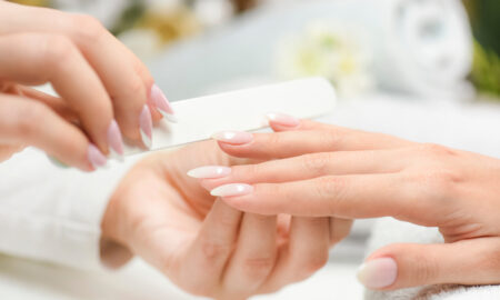 why-french-manicure-is-best-for-summer-to-fall-woman-getting-manicure-done