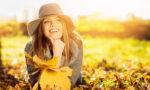 fall-lipstick-shades-for-brunettes-brunette-smiling-outside-fall
