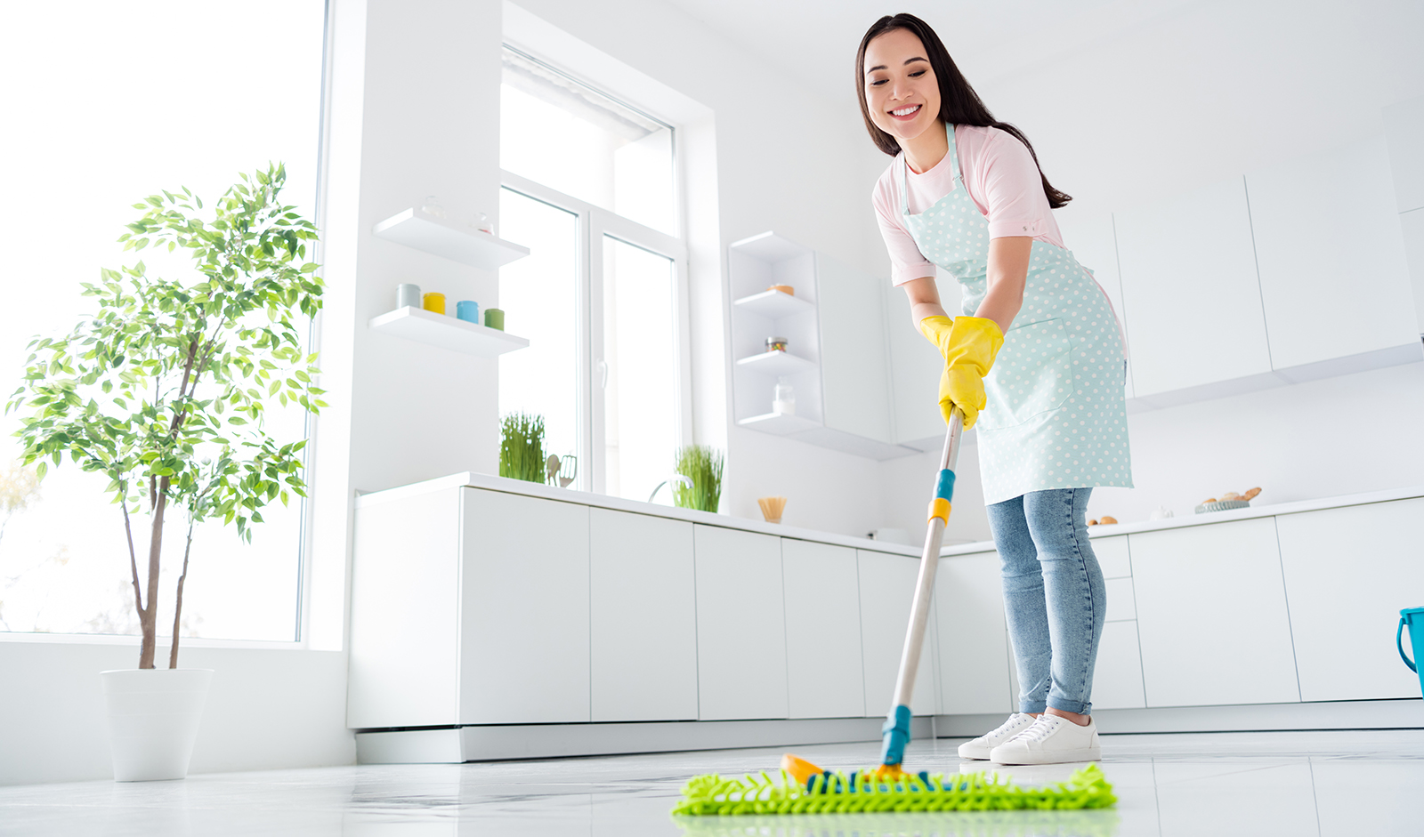 reasons-to-hire-a-professional-cleaner-main-image-woman-cleaning-floor