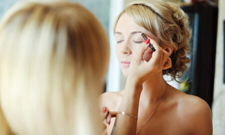 should-you-use-airbrush-makeup-woman-getting-makeup-applied
