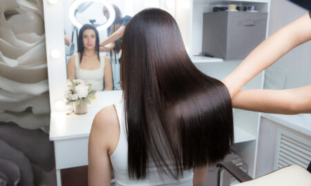 stop-thinning-hair-remedies-and-prevention-tips-woman-in-salon-looking-in-mirror